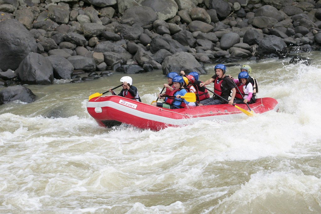 Plunging into the rapids and paddling hard. Photo by Rhonson Ng