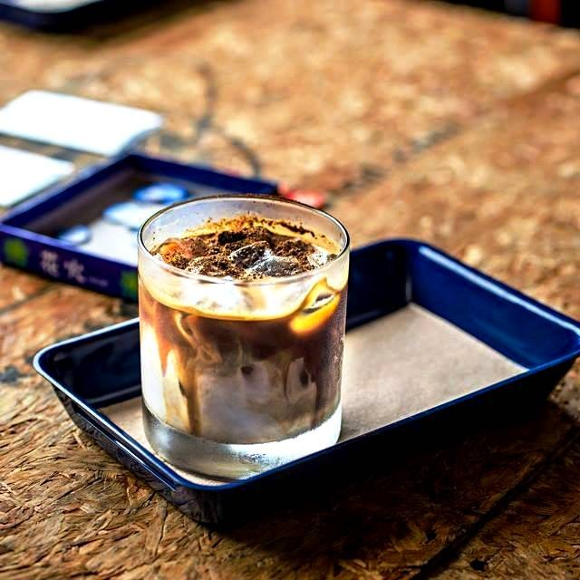The 'Dirty White' - hot espresso layered over cold milk and topped with coffee grounds. Photo courtesy of EDSA BDG