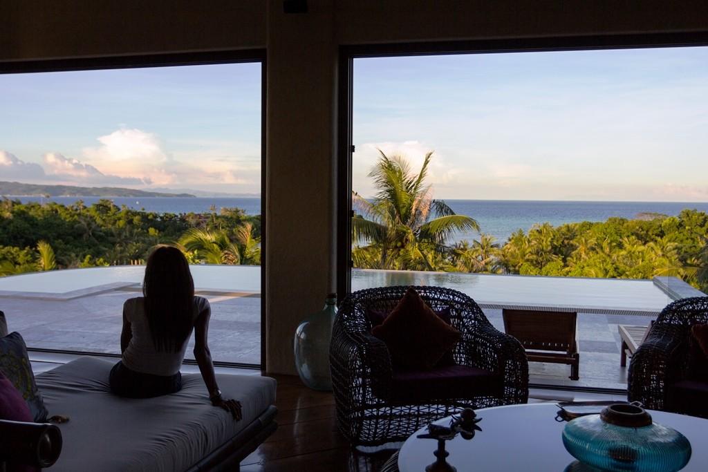 The good life: Elena Fernandez relaxes on her veranda overlooking the infinity pool