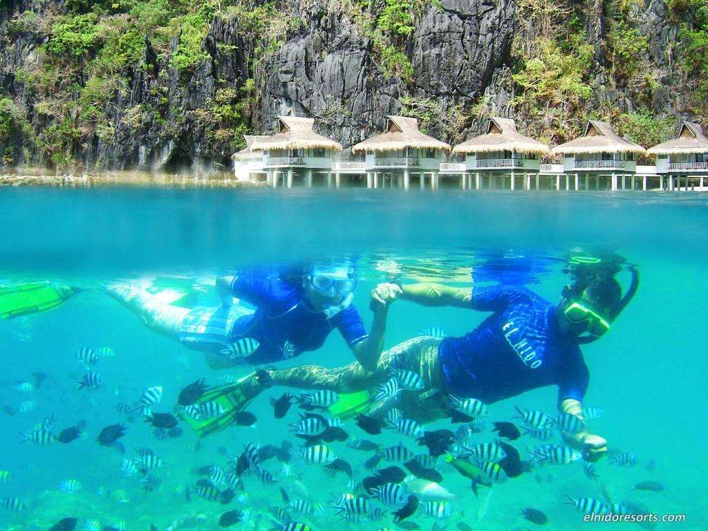 Snorkelling in the waters of Miniloc Island resort's house reef. By El Nido Resorts
