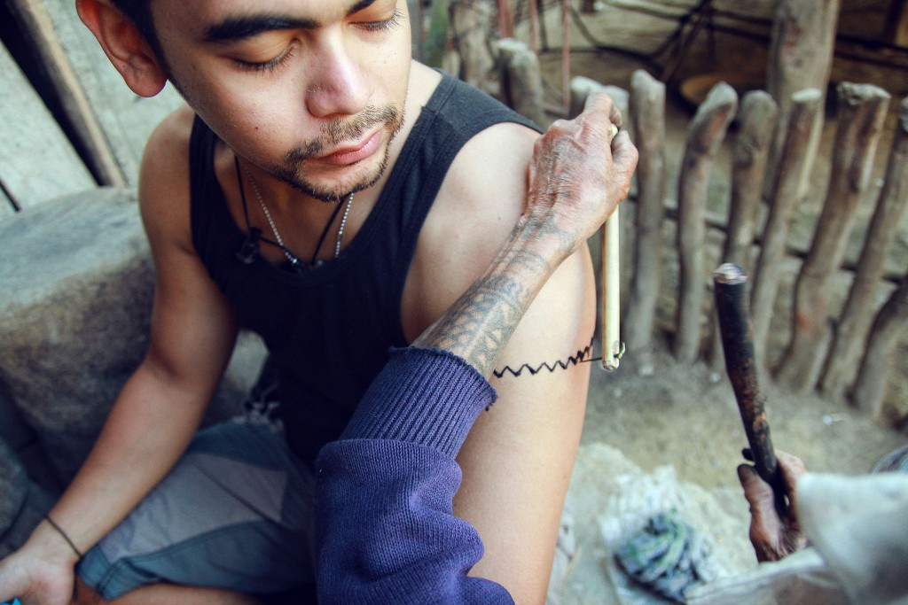 Getting a traditional tattoo in Buscalan, Kalinga. Courtesy of Julian Rodriguez