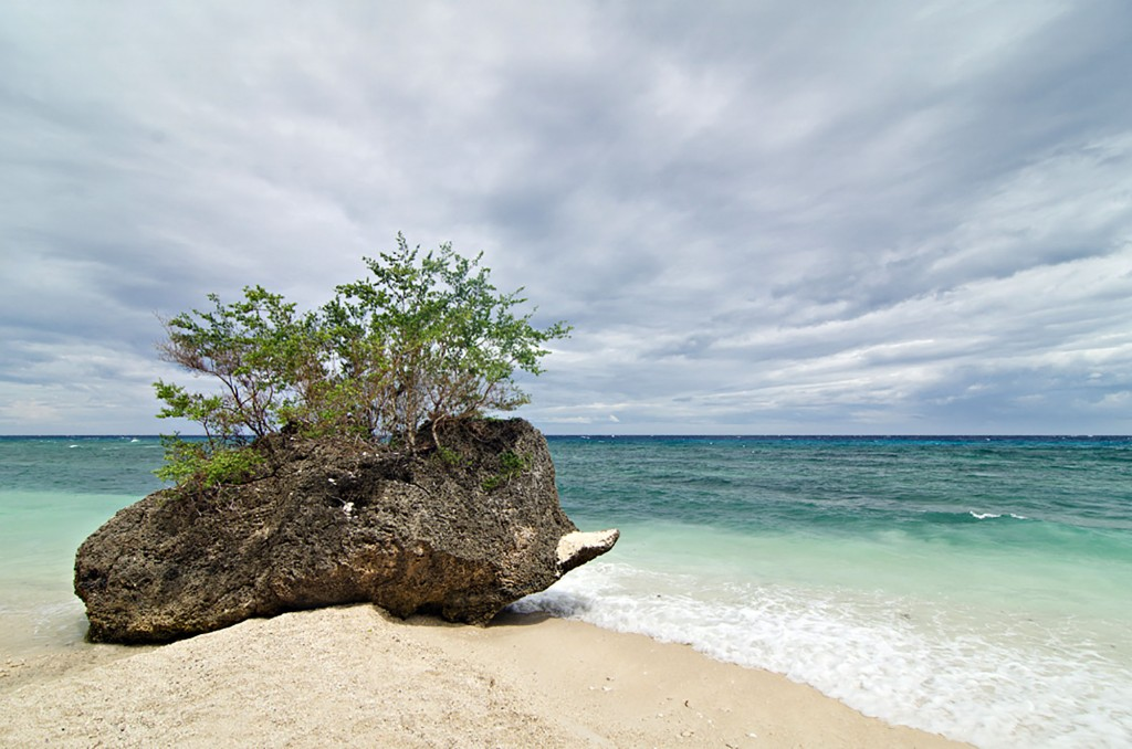 One of Siquijor's sparkling white beaches, with no one around. By Christian Sangoyo