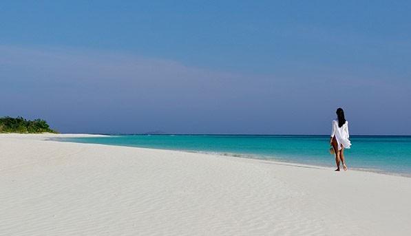 Amanpulo resort's white sandy beach