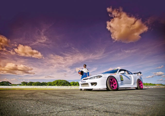 Drift driver Audel Sison poses with his car, fully set up for drifting
