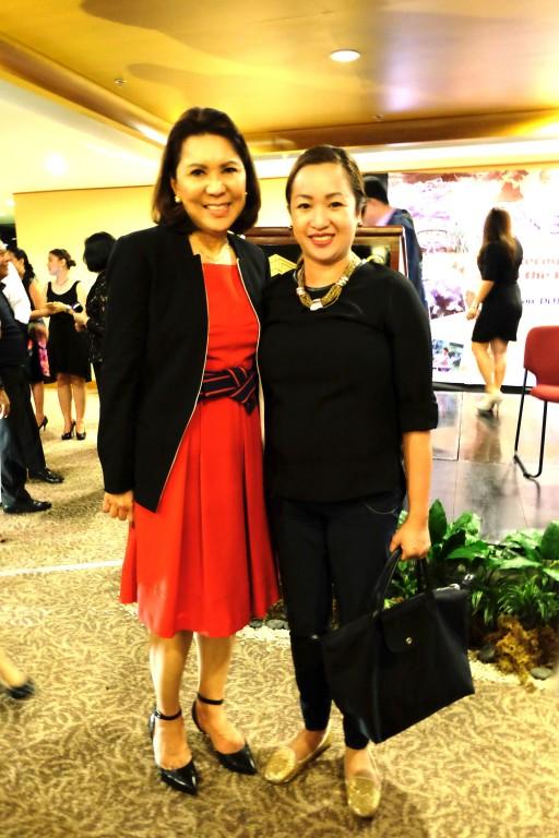 Dornier Media sales and marketing manager Lovenia Lim (right) with DOT secretary Wanda Teo