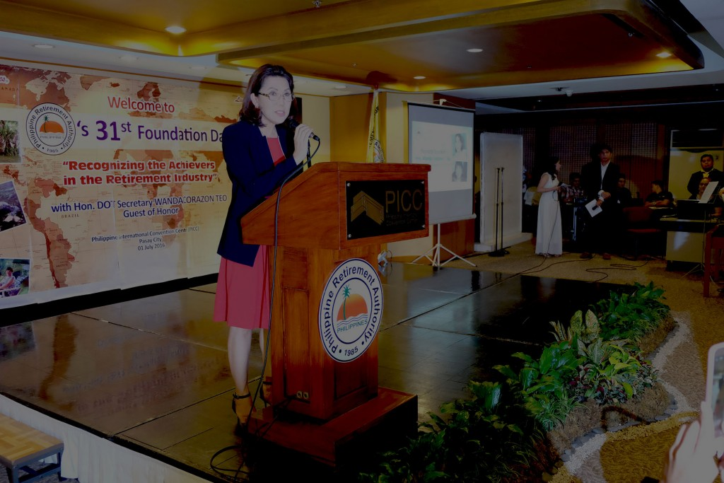 DOT secretary Wanda Teo speaking before 300 PRA employees and guests