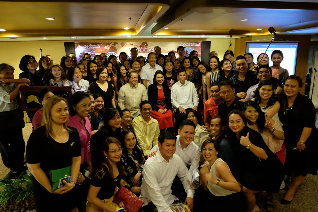 ALL SMILES: PRA staff with Department of Tourism secretary Wanda Teo (seated centre in red dress) and PRA general manager Valentino Cabansag (left from Teo)
