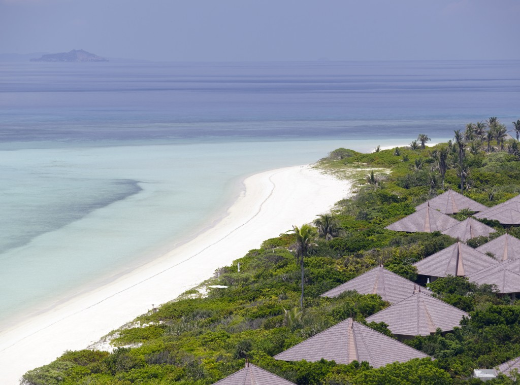View of Amanpulo's villas and the white-sand beach surrounding it
