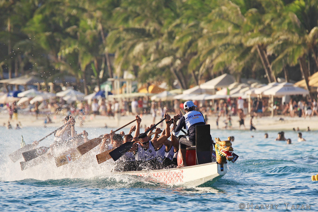 Dragonboat racing along White Beach, Boracay Island. By Harvey Tapan