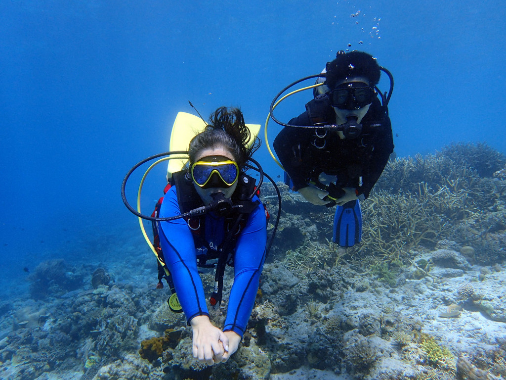 Mariglo (left) exploring El Nido's underwater life with son Benjamin